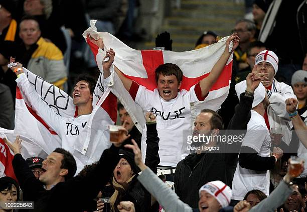 England fans celebrate during the Cook Cup Test Match between the Australian Wallabies and England at ANZ Stadium on June 19, 2010 in Sydney,...