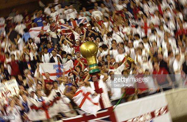 England fans celebrate during the FIFA World Cup Finals 2002 Second Round match between Denmark and England played at the Niigata Big Swan Stadium in...