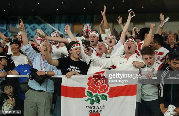 England fans celebrate during the Rugby World Cup 2019 SemiFinal match between England and New Zealand at International Stadium Yokohama on October...