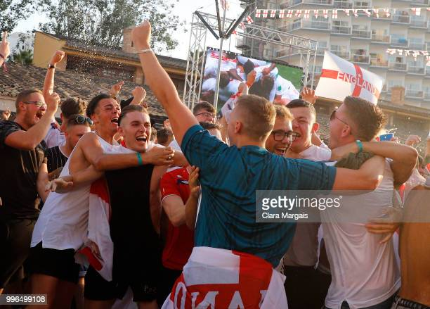 England fans celebrate England's opening goal while watching the World Cup semifinal match against Croatia on a giant screen in an open air viewing...