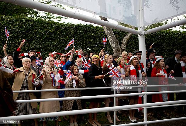 England fans celebrate the 1966 World Cup victory at the entrance to Goodwood on September 9 2016 in Chichester England