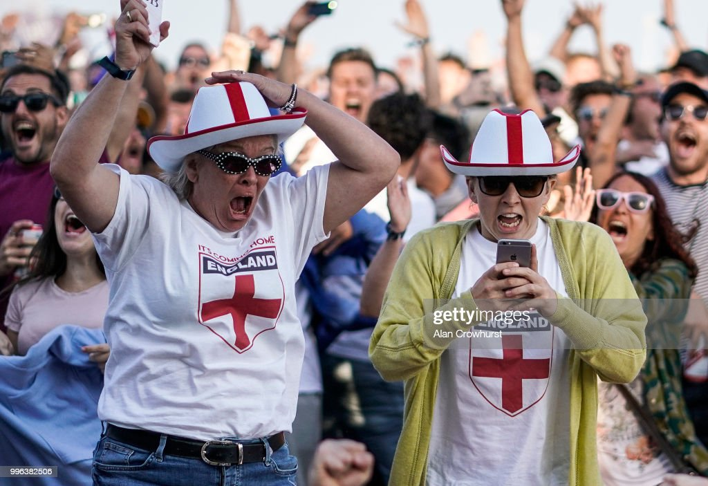 England fans celebrate the first goal of the game during the 2018 FIFA World Cup semi final match between Croatia and England at the Luna Beach Cinema on Brighton Beach on July 11, 2018 in Brighton, United Kingdom.