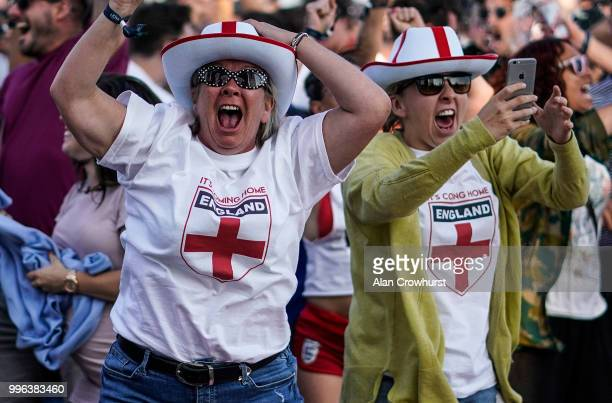 England fans celebrate the first goal of the game during the 2018 FIFA World Cup semi final match between Croatia and England at the Luna Beach...