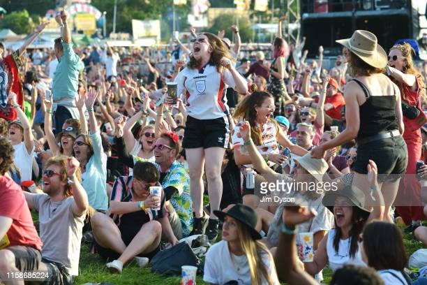 England fans celebrate the first goal of the Women's World Cup Quarter Final between England and Norway, during day two of Glastonbury Festival at...