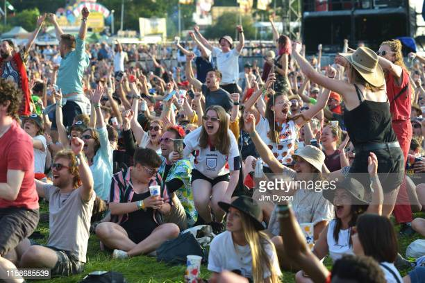 England fans celebrate the first goal of the Women's World Cup Quarter Final between England and Norway during day two of Glastonbury Festival at...