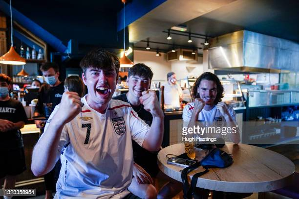 England fans celebrate their team scoring in the Five Degrees West pub on June 13, 2021 in Falmouth, England. Due to the good weather and a few new...