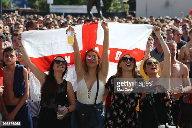 England fans celebrate while watching England take on Sweden in the World Cup quarter finals at Ashton Gate World Cup fans village at the Bristol...