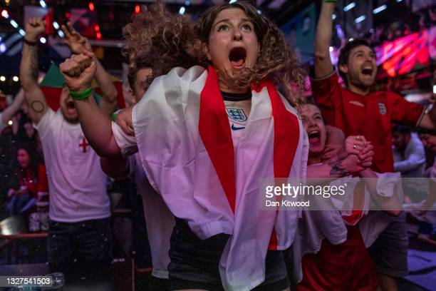 England fans cheer at BOXPARK Croydon as they watch a live broadcast of the semi-final match between England and Denmark on July 07, 2021 in London,...