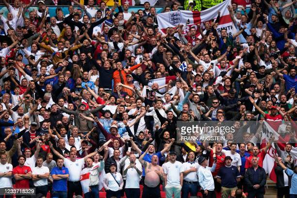 England fans cheer before the UEFA EURO 2020 round of 16 football match between England and Germany at Wembley Stadium in London on June 29, 2021.
