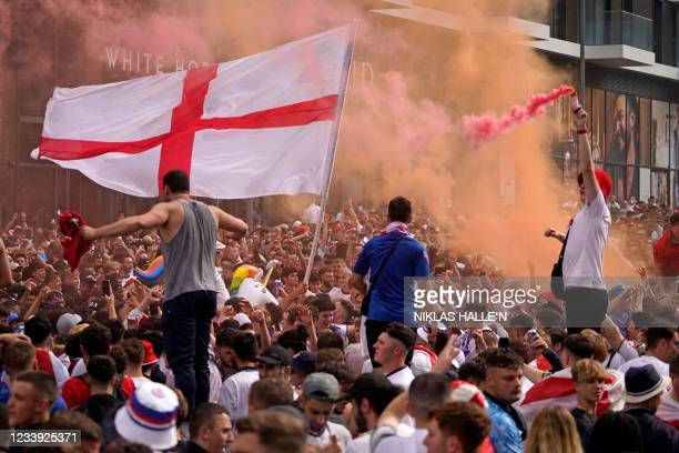 England fans cheer on their team outside Wembley Stadium ahead of the UEFA EURO 2020 final football match between England and Italy in northwest...