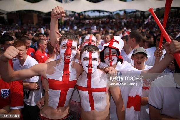 England fans cheer their team during the England v Germany World Cup match being shown a giant screen in the Manchester fan zone on June 27 2010 in...