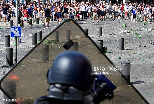 England fans clash with police personnel as England fans gather in the city of Marseille southern France on June 11 ahead of the Euro 2016 football...