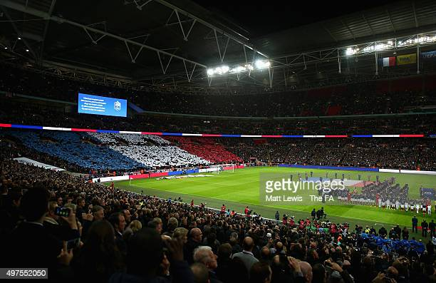 England fans display the colours of the French flag remember those who lost their lives in the recent Paris attack prior to the International...
