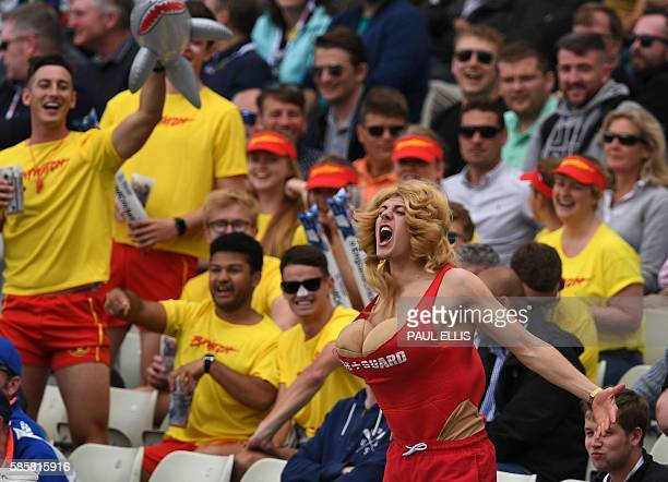 England fans dressed as Baywatch characters Pamela Anderson impersonator front right in the crowd during play on the second day of the third test...