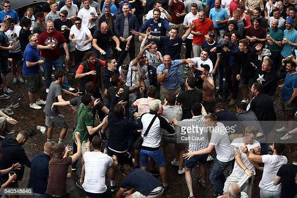 England fans drink dance and shout outside a bar as they gather ahead of Thursday's match between England and Wales on June 15 2016 in Lille France...