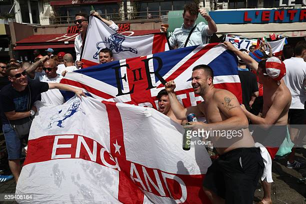 England fans gather and cheer with their flags ahead of the game against Russia later today on June 11 2016 in Marseille France Football fans from...