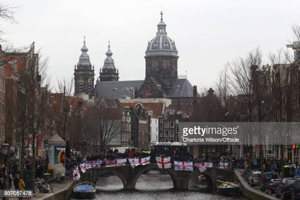England fans hang flags on a canal bridge before the International Friendly match between Netherlands and England at Amsterdam Arena on March 23 2018...