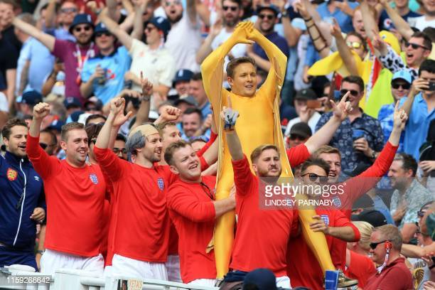 England fans in fancy dress reenact the celebrations after the England football team won the world cup in 1966 in the crowd during play on the third...