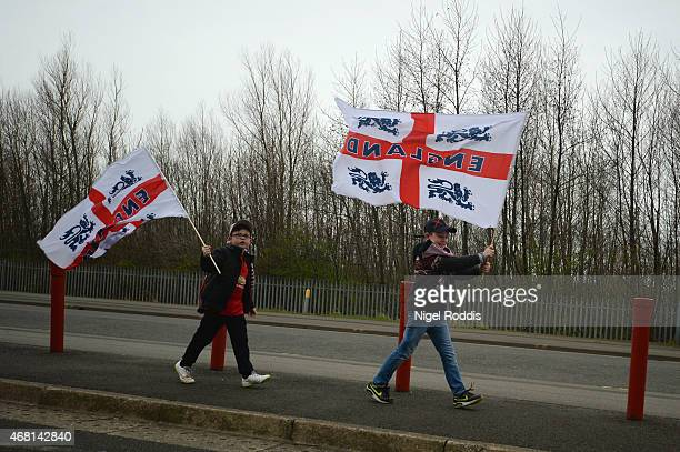 England fans make their way to the stadium prior to the international friendly between England Under 21 and Germany Under 21 at Riverside Stadium on...