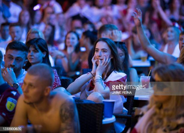 England fans on holidays react to watching the penalties shootout after the UEFA EURO 2020 final football match between Italy and England at a bar of...