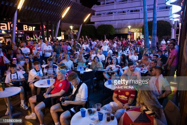 England fans on holidays watch the UEFA EURO 2020 final football match between Italy and England at a bar of Magaluf in Calvia on the Spanish...