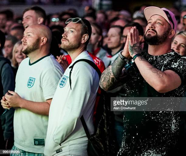England fans pray for the best during the 2018 FIFA World Cup semi final match between Croatia and England at the Luna Beach Cinema on Brighton Beach...