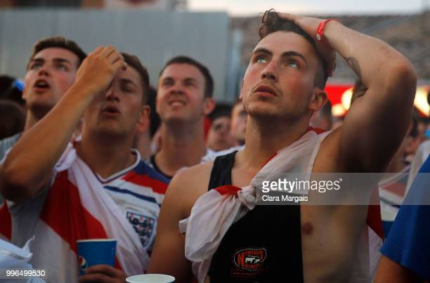 England fans react as they gather to watch the World Cup semifinal match against Croatia on July 11 2018 in Magaluf Mallorca Spain The England team...