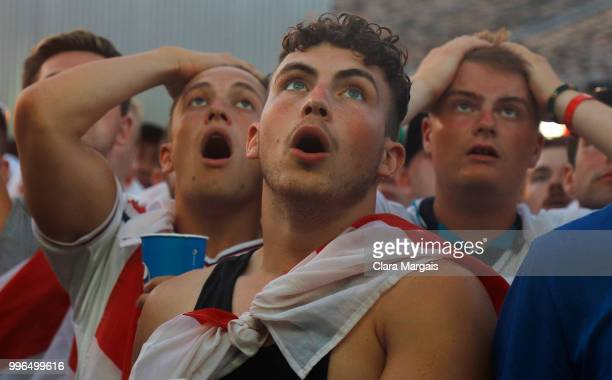 England fans react as they gather to watch the World Cup semifinal match against Croatia in an open air viewing area on July 11 2018 in Magaluf...