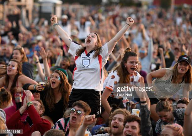 England fans react as they watch England's victory over Norway in the 2019 FIFA Women's World Cup quarter-finals on the West Holts stage during day...