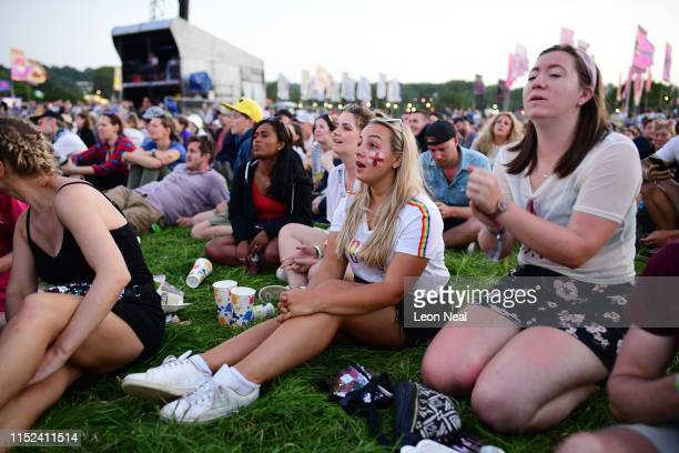 England fans react as they watch England's victory over Norway in the 2019 FIFA Women's World Cup quarterfinals on the West Holts stage during day...