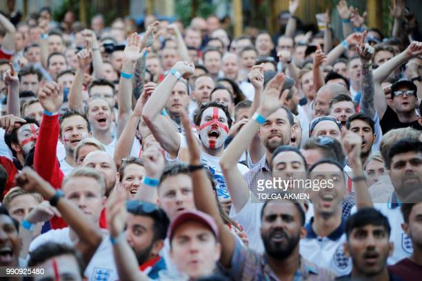TOPSHOT England fans react as they watch the Russia 2018 World Cup round of 16 football match between Colombia and England on a big screen in London...