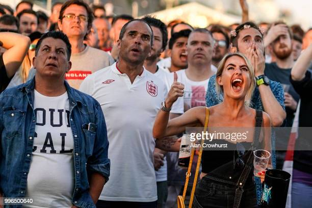 England fans react during the 2018 FIFA World Cup semi final match between Croatia and England at the Luna Beach Cinema on Brighton Beach on July 11...