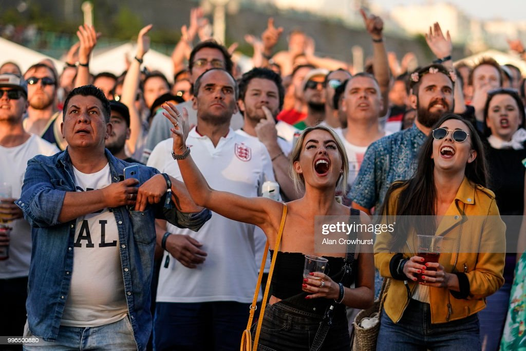 England fans react during the 2018 FIFA World Cup semi final match between Croatia and England at the Luna Beach Cinema on Brighton Beach on July 11, 2018 in Brighton, United Kingdom.