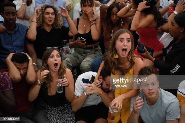England fans react in horror to Colombia's equaliser at the end of extra time as they watch the FIFA 2018 World Cup Finals match between Colombia and...