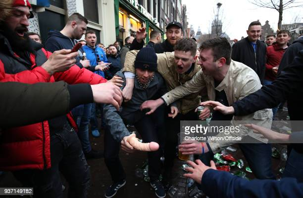 England fans react to a dildo ahead of the International Friendly match between Netherland and England at Amsterdam Arena on March 23 2018 in...