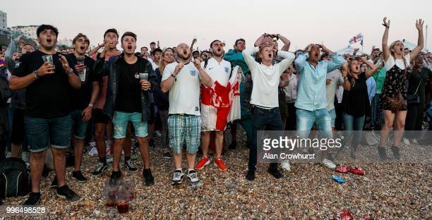 England fans react to a near miss during the 2018 FIFA World Cup semi final match between Croatia and England at the Luna Beach Cinema on Brighton...