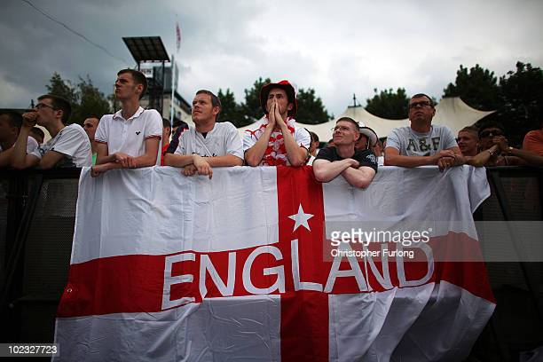 England fans react to tense moments while watching the England team beat Slovenia 10 on a giant screen in the Manchester fan zone on June 23 2010 in...