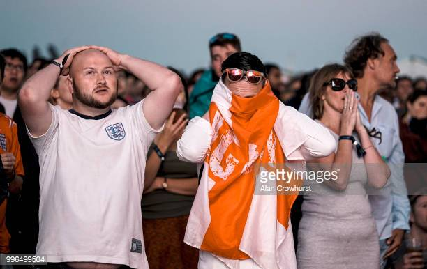 England fans react to the winning goal as Croatia score during the 2018 FIFA World Cup semi final match between Croatia and England at the Luna Beach...
