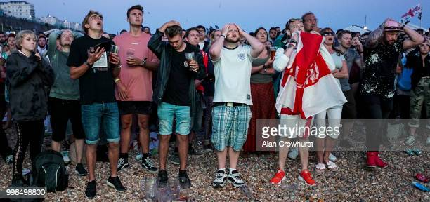 England fans react to winning goal as Croatia score during the 2018 FIFA World Cup semi final match between Croatia and England at the Luna Beach...