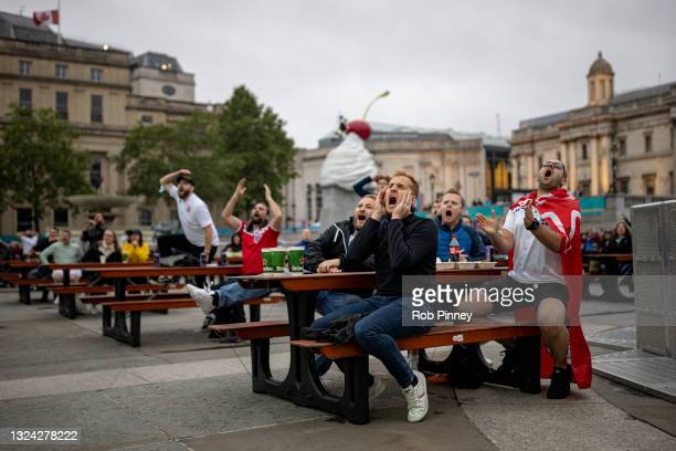 England fans react while watching the game in a fan zone at Trafalgar Square on June 18, 2021 in London, England. The fan zone was opened to key...