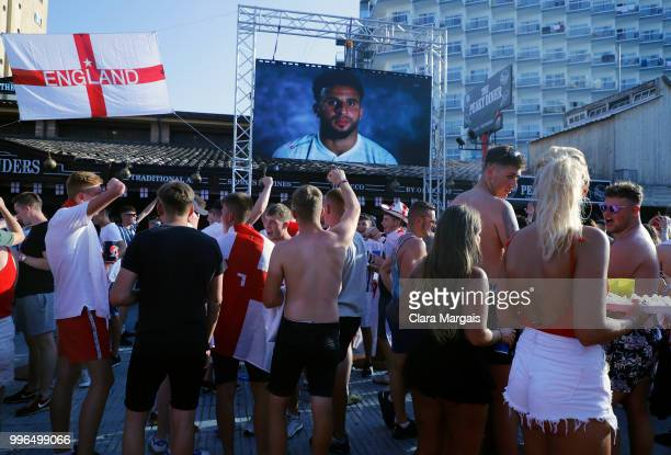 England fans react while watching the World Cup semifinal match against Croatia on a giant screen in an open air viewing area on July 11 2018 in...