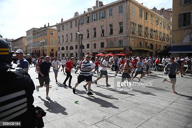 England fans run during clashes with other fans and the police ahead of the game against Russia later today on June 11 2016 in Marseille France...