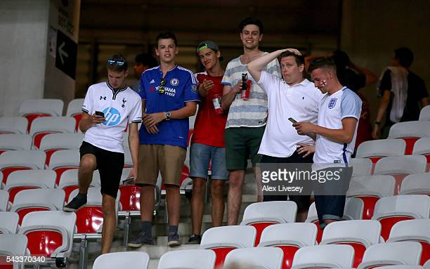 England fans show their dejection after their team's 12 defeat in the UEFA EURO 2016 round of 16 match between England and Iceland at Allianz Riviera...