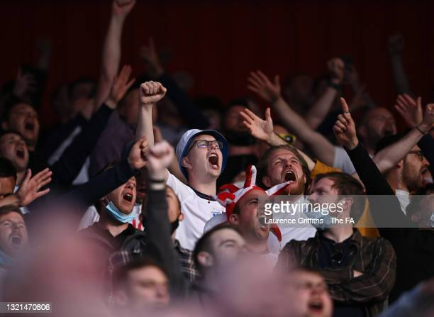 England fans sing the National Anthem ahead of the international friendly match between England and Austria at Riverside Stadium on June 02, 2021 in...
