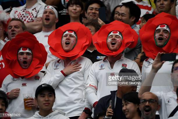 England fans sing the national anthem before the Japan 2019 Rugby World Cup quarterfinal match between England and Australia at the Oita Stadium in...