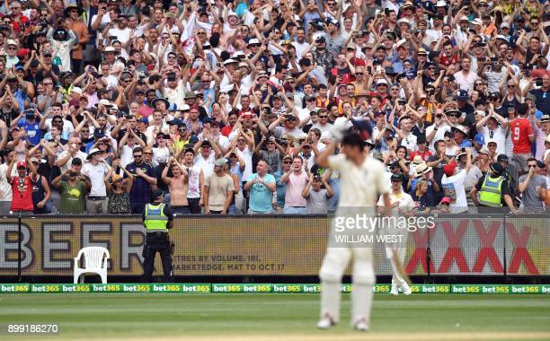 TOPSHOT England fans The Barmy Army cheer England batsman Alastair Cook after scoring his double century against Australia on the third day of the...