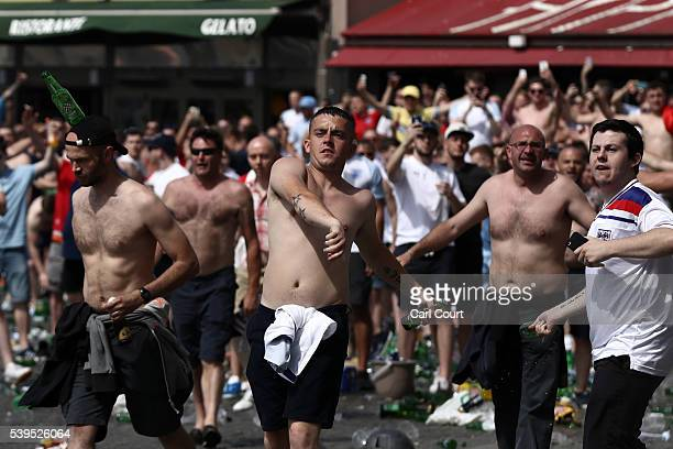 England fans throw bottles as they clash with police ahead of the game against Russia later today on June 11 2016 in Marseille France Football fans...