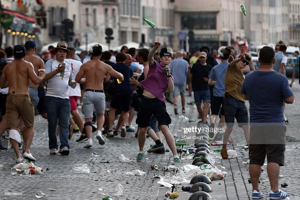 England fans throw bottles at police in Marseille ahead of the opening game of the UEFA Euro 2016 tournament later today on June 10, 2016 in Marseille, France. Football fans from around Europe have descended on France for the UEFA Euro 2016 football tournament.
