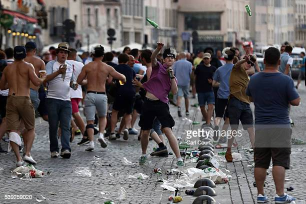 England fans throw bottles at police in Marseille ahead of the opening game of the UEFA Euro 2016 tournament later today on June 10 2016 in Marseille...