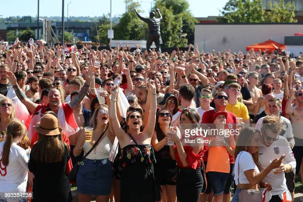 England fans watch England take on Sweden in the World Cup quarter finals at Ashton Gate World Cup fans village at the Bristol City football club on...